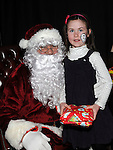 Caoimhe Durnin pictured with Santa at Ballapoosta christmas fair. Photo: Colin Bell/pressphotos.ie