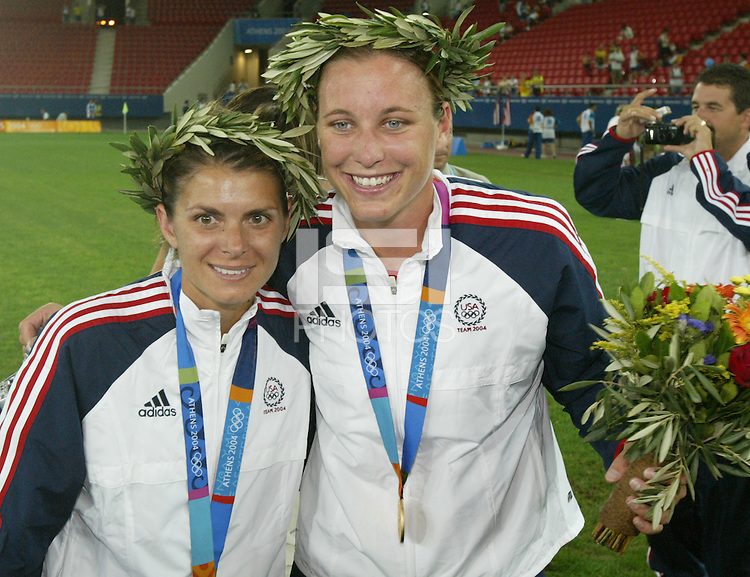 26 August 2004:  Mia Hamm and Abby Wambach pose for photo after defeating Brazil, 2-1 in overtime at Karaiskakis Stadium in Athens, Greece.  Credit: Michael Pimentel / ISI.
