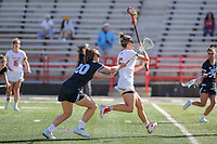 College Park, MD - April 27, 2019: Maryland Terrapins midfielder Jen Giles (5) runs pass John Hopkins Bluejays Lexi Souder (20) during the game between John Hopkins and Maryland at  Capital One Field at Maryland Stadium in College Park, MD.  (Photo by Elliott Brown/Media Images International)