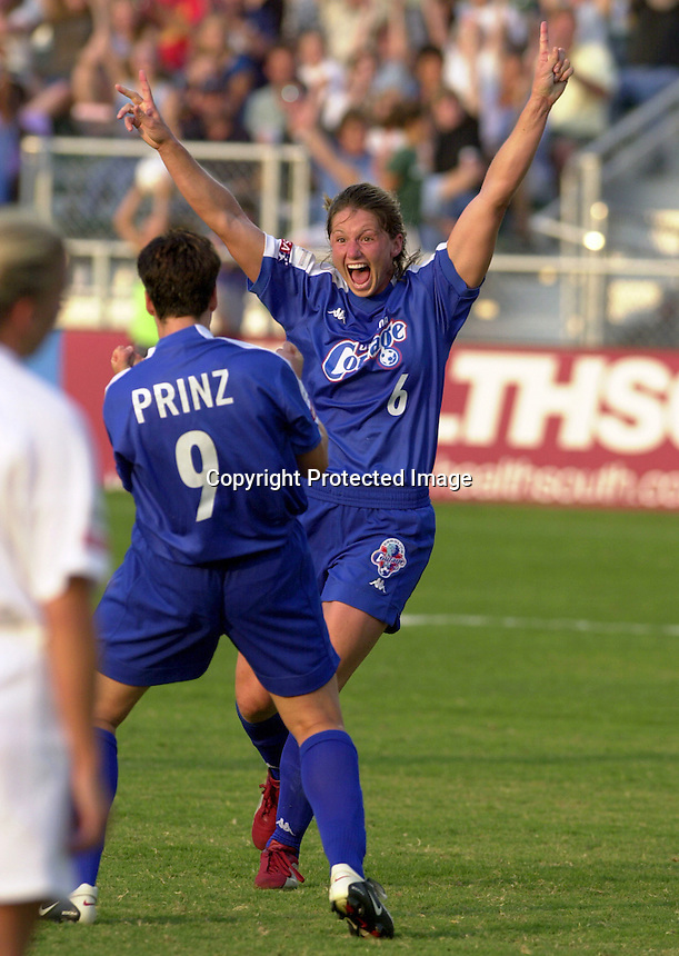 Carolina Courage forward Danielle Fotopoulos (6) celebrates her first half goal with teammate Birgit Prinz (9) during their game with the Philadelphia Charge Wednesday, June 19, 2002 at SAS Stadium in Cary, N.C.. The Courage lost the game to the Charge 3-1.<br /> SportServer/Stan Gilliland