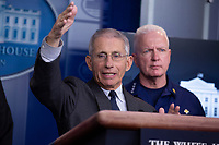 Director of the National Institute of Allergy and Infectious Diseases at the National Institutes of Health Dr. Anthony Fauci makes remarks on the Coronavirus crisis in the Brady Press Briefing Room of the White House in Washington, DC on Saturday, March 21, 2020.  Looking on at right is Admiral Brett Giroir, United States Assistant Secretary for Health.<br /> Credit: Stefani Reynolds / Pool via CNP/AdMedia