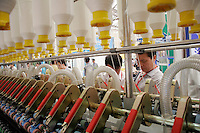 Visitors looking at textile machinery on display at the ShanghaiTex 2005, a textile industry exhibition in Shanghai, China. China is currently engaged in heated trade disputes with both the European Union and then United States over its exports of textiles to these two areas..05 Jun 2005