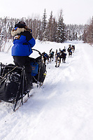 Thursday March, 2012  Rohn Buser 's team heads down the trail after leaving the Ophir checkpoint.   Iditarod 2012.