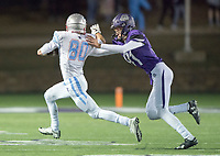 NWA Democrat-Gazette/CHARLIE KAIJO Fayetteville High School kicker Porter Smith (91) grabs on to Southside High School wide receiver Mason Love (80) during a playoff football game on Friday, November 10, 2017 at Fayetteville High School in Fayetteville.