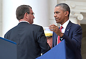 United States President Barack Obama (R) shakes hands with US Secretary of Defense Ashton Carter after his remarks at the Amphitheater at Arlington National Cemetery, Arlington, Virginia, on Memorial Day, May 30, 2016, near Washington, DC. Obama paid tribute to the nation's military service members who have fallen.            <br /> Credit: Mike Theiler / Pool via CNP