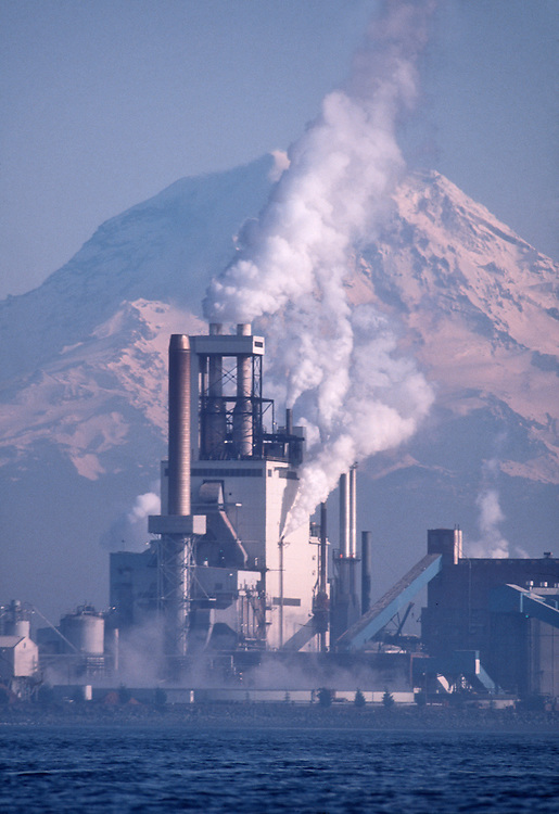 Puget Sound, Mount Rainier, Pulp Mill vents wast steam, pollution and effluent in to Commencement Bay, Simpson Paper Company, Simpson Tacoma Kraft Mill, manufactures bleached and unbleached kraft pulp. Washington State. Pacific Northwest, West Coast, USA