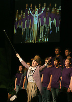 NWA Democrat-Gazette/DAVID GOTTSCHALK   Warren Rosenaur, director of theater at Fayetteville High School, performs as the character Willy Wonka Friday, August 11, 2017, with the Fayetteville High School Encore Choir during the opening of the Imagine the Possibilities Fayetteville Public Schools Convocation 2017 inside the high school arena on the campus. The convocation included performances with the high school band, keynote speaker Matthew Wendt, superintendent of schools followed by the 30th annual Fayetteville Education Expo.