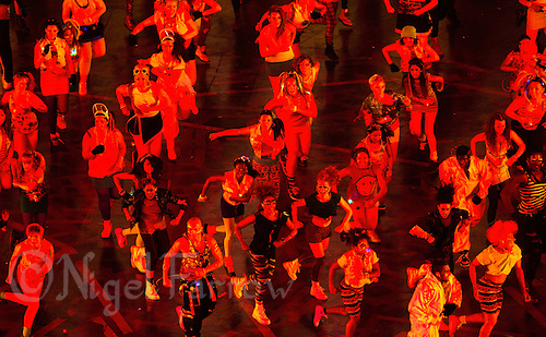 "27 JUL 2012 - LONDON, GBR - Dancers perform during the ""Frankie and June say...thanks Tim"" section of the Opening Ceremony of the London 2012 Olympic Games in the Olympic Stadium in the Olympic Park, Stratford, London, Great Britain .(PHOTO (C) 2012 NIGEL FARROW)"