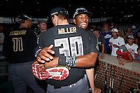 Christian Jones (5) of Federal Way Senior High School in Federal Way, Washington hugs Mitchell Miller (30) of Loganville High School in Covington, Georgia after the Under Armour All-American Game on August 15, 2015 at Wrigley Field in Chicago, Illinois. (Mike Janes/Four Seam Images)