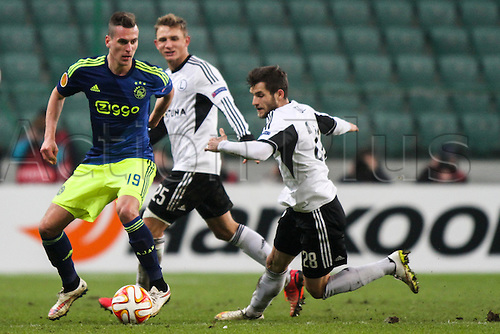 26.02.2015. Warsaw, Poland. Europa League football. Legia Warsaw versus Ajax.  Arkadiusz Milik (Ajax) tries to cover Lukasz Broz (Legia)and Jakub Rzezniczak (Legia)