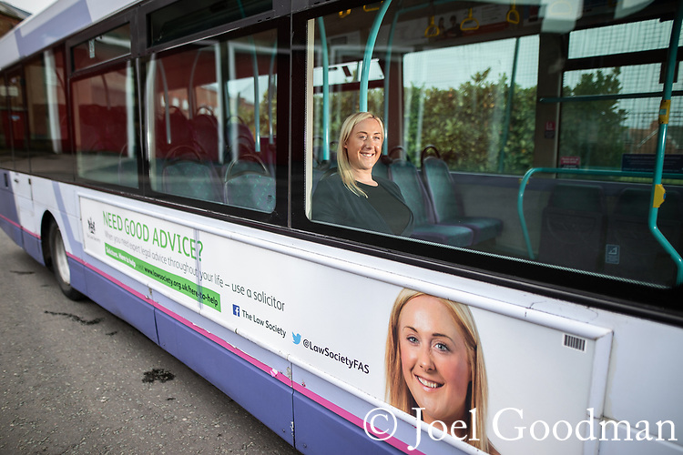 © Joel Goodman - 07973 332324 . 24/04/2018 .  Manchester , UK . RUTH PETERS in front of Law Society bus ad in which she features . Photo credit: Joel Goodman