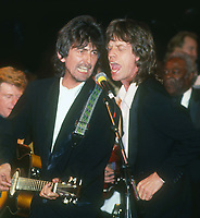 George Harrison Mick Jagger 1985<br /> Photo By John Barrett/PHOTOlink.