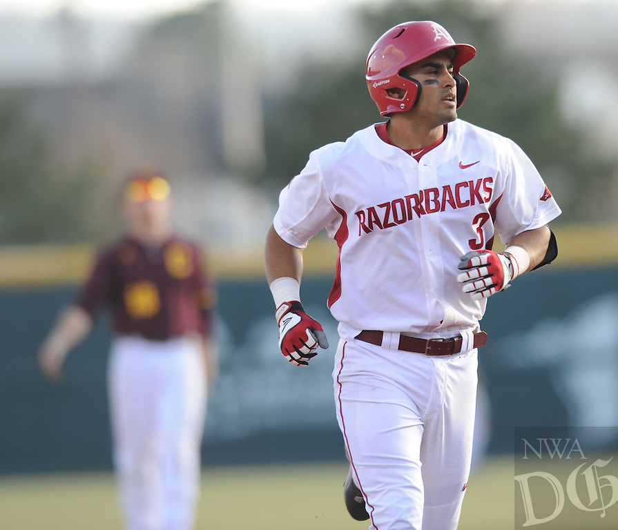 NWA Democrat-Gazette/ANDY SHUPE<br /> of Arkansas of Central Michigan Friday, Feb. 19, 2016, during the inning at Baum Stadium in Fayetteville. Visit nwadg.com/photos to see more photographs from the game.