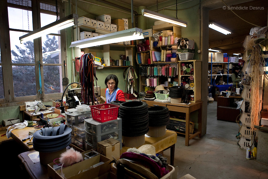 9 december 2009 - Coustilleres' hat factory, Septfonds, France - .Septfonds is the heart of French straw hat making, due to its very ancient hatter tradition. The hat making industry had its commercial peak in the late 19th century..Coustillères is a family owned hat making factory that has been making straw hats in Septfonds for nearly 100 years. They make hats from straw, felt, and cloth as well as caps. The current owner is Jean-Claude Coustilleres. He is one of the last hat makers of the region..The straw hat making process is very labor intensive and numerous hands are involved. Nearly all of the equipment is over 100 years old, they use the original presses and tools including aluminium molds and sewing machines and dye their own straw continuing the traditional methods of manufacturing. The hat blocking and shaping, straw braids construction and dyeing are all done by hand..The company works on behalf of fashion houses and makes a variety of regional and historical hats. It produces 2 collections a year distributed by a network of salespeople and through a catalog to clients around the world. Photo credit: Benedicte Desrus