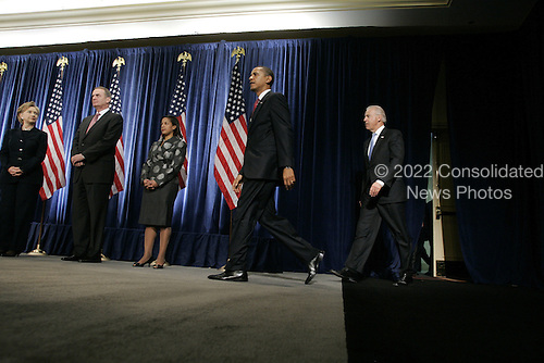 Chicago, IL - December 1, 2008 -- United States President-elect Barack Obama walks out to give a press conference to introduce nominees United States Senator Hillary Rodham Clinton (Democrat of New York), left, for Secretary of State, retired Marine General James L. Jones, middle, chosen as national security adviser, and Susan Rice as United Nations ambassador at the Chicago Hilton & Towers in Chicago, Illinois.  Vice President-elect Joe Biden, right, accompanied Obama..Credit: Anne Ryan - Pool via CNP