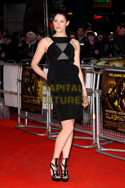 GEMMA ARTERTON .World Premiere of 'Clash of the Titans' at the Empire cinema, Leicester Square, London, England, March 29th 2010..arrivals full length black dress sleeveless hand in pocket platform strappy sandals high heels sheer mesh insert see thru through gladiator fishnet .CAP/AH.©Adam Houghton/Capital Pictures.