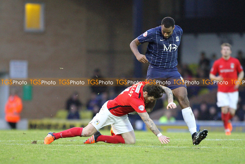 Romain Vincelot of Coventry City goes down under pressure from Tyrone Barnett of Southend United during Southend United vs Coventry City, Sky Bet League 1 Football at Roots Hall, Southend, England on 23/01/2016