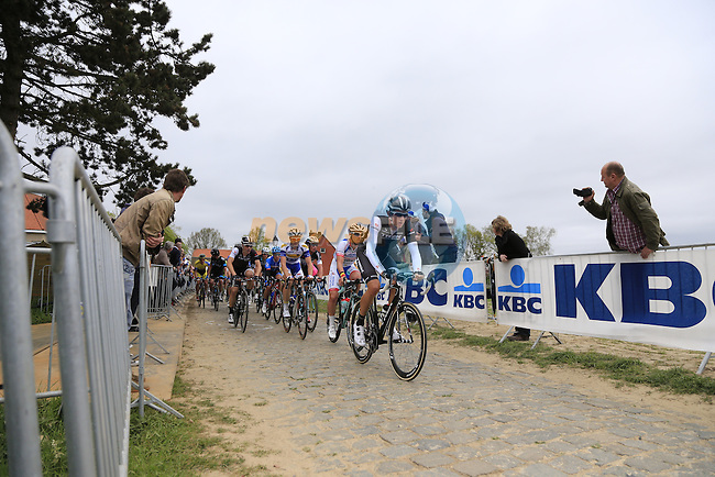 The chasing peleton, led by Jesse Sergent (NZL) Trek Factory Racing, climb the Oude Kwaremont during the 2014 Tour of Flanders, Belgium.<br /> Picture: Eoin Clarke www.newsfile.ie