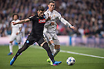 Cristiano Ronaldo of Real Madrid (in white) fights for the ball with Elseid Hysaj of SSC Napoli (in black) with during the match Real Madrid vs Napoli, part of the 2016-17 UEFA Champions League Round of 16 at the Santiago Bernabeu Stadium on 15 February 2017 in Madrid, Spain. Photo by Diego Gonzalez Souto / Power Sport Images