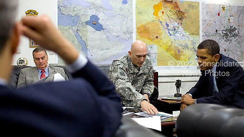 Baghdad, Iraq - April 7, 2009 -- United States President Barack Obama receives a briefing from U.S. General Raymond T. Odierno, center, commanding general of the multi-national force in Iraq, joined by National Security Advisor General James Jones, background-left, Tuesday, April 7. 2009 at Camp Victory, Iraq. .Credit: Pete Souza - White House via CNP