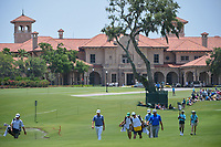 Ben Martin (USA), Robert Garrigus (USA), and Derek Fathauer (USA) head down 1 with the TPC Sawgrass clubhouse in the background during round 1 of The Players Championship, TPC Sawgrass, at Ponte Vedra, Florida, USA. 5/10/2018.<br /> Picture: Golffile | Ken Murray<br /> <br /> <br /> All photo usage must carry mandatory copyright credit (&copy; Golffile | Ken Murray)