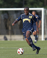 Quinnipiac University forward Remere Warner (10) brings the ball forward. Boston College defeated Quinnipiac, 5-0, at Newton Soccer Field, September 1, 2011.