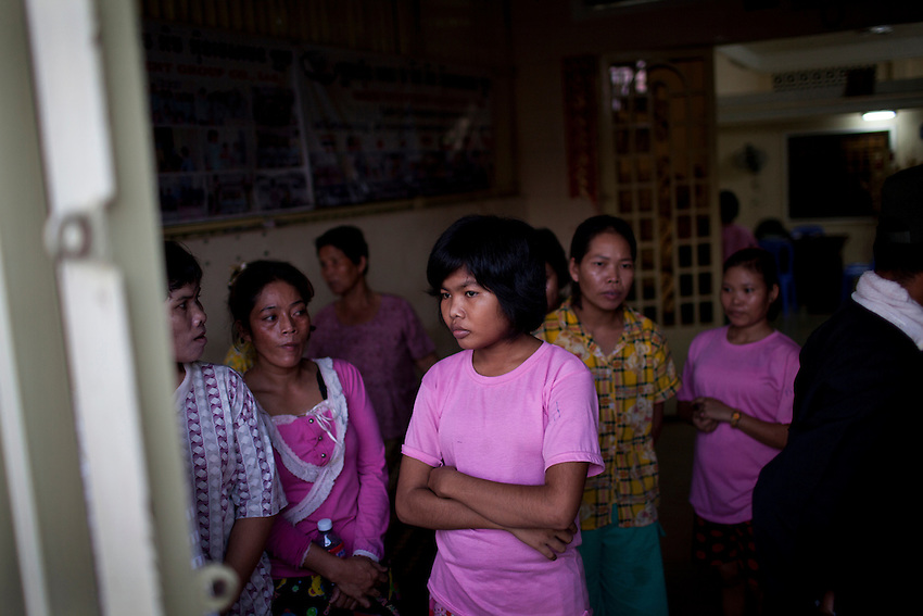 A 15-year-old domestic migrant worker is seen at an SKMM Investment Group training centre in Russey Keo district, Phnom Penh, October 19, 2011. The recruitment firm, which sends Cambodian maids to Malaysia for placement, was raided the following day. More than 70 women, including a number of underage girls, were freed from the company's three training centers in Phnom Penh. According to Cambodian law, domestic workers must be at least 21 years of age to travel to Malaysia to work as maids, however some of the recruits who were as young as 15 and 16 and stated that the company had falsified travel documents to bypass the rules.