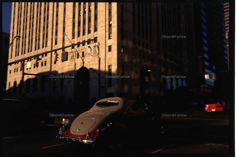 A historic car drives through the center of Columbus on Main Street which was the National Road as it came through Ohio's state captial.