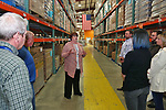 Linda Keenan (C) Director of Development for the Food Bank of Monmouth & Ocean, give a facility tour to Jersey Central Power & Light Employees after JCP&L presented a check for $6,528.00 to The Food Bank of Monmouth & Ocean Counties in Neptune, NJ on April 13, 2017.