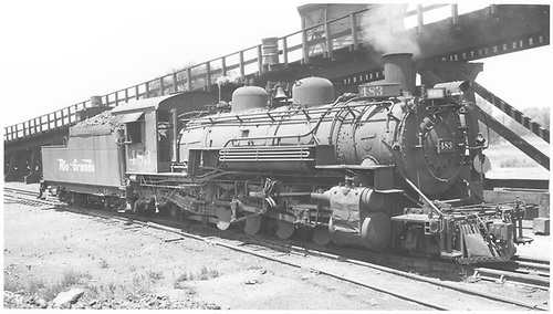 3/4 engineer side view of K-36 #483 at coaling trestle in Alamosa with water tank behind trestle.<br /> D&amp;RGW  Alamosa, CO  Taken by Ward, Bert H. - 7/12/1947