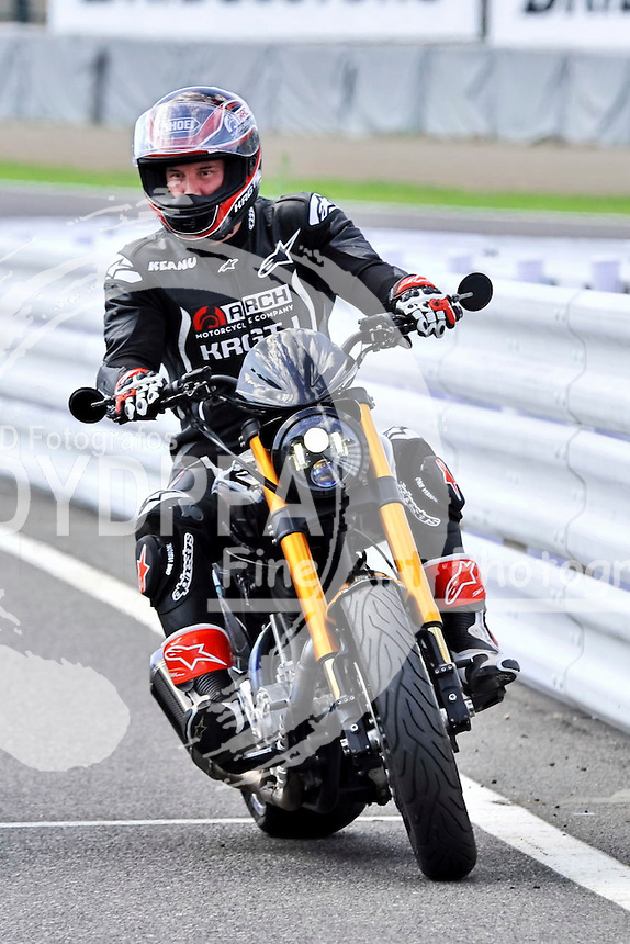 Actor Keanu Reeves test-rides his Arch Motorcycle 'KRGT-1' during the Suzuka 8 Hours FIM Endurance world championship at Suzuka Circuit in Mie prefecture, Japan on July 25, 2015.
