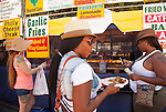 People gather around the food booths at the 29th annual Pittsburg Seafood and Music Festival on Sunday, September 8th, 2013 in Pittsburg, California.  Photo/Victoria Sheridan