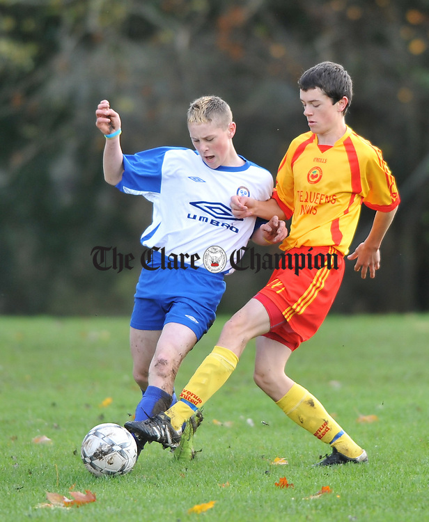 Conor Rudden of Ennis Town in action against Eanna Fennell of Avenue United during their U-15 Evans Cup game at Ennis National School pitch. Photograph by John Kelly.
