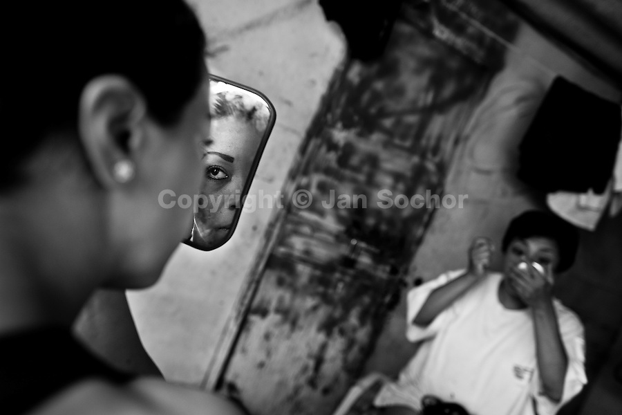 "Female Lucha libre wrestlers apply makeup in the backstage before a fight at a local arena in Mexico City, Mexico, 30 April 2011. Lucha libre, literally ""free fight"" in Spanish, is a unique Mexican sporting event and cultural phenomenon. Based on aerial acrobatics, rapid holds and the use of mysterious masks, Lucha libre features the wrestlers as fictional characters (Good vs. Evil). Women wrestlers, known as luchadoras, often wear bright shiny leotards, black pantyhose or other provocative costumes. Given the popularity of Lucha libre in Mexico, many wrestlers have reached the cult status, showing up in movies or TV shows. However, almost all female fighters are amateur part-time wrestlers or housewives. Passing through the dirty remote areas in the peripheries, listening to the obscene screams from the mainly male audience, these no-name luchadoras fight straight on the street and charge about 10 US dollars for a show. Still, most of the young luchadoras train hard and wrestle virtually anywhere dreaming to escape from the poverty and to become a star worshipped by the modern Mexican society."