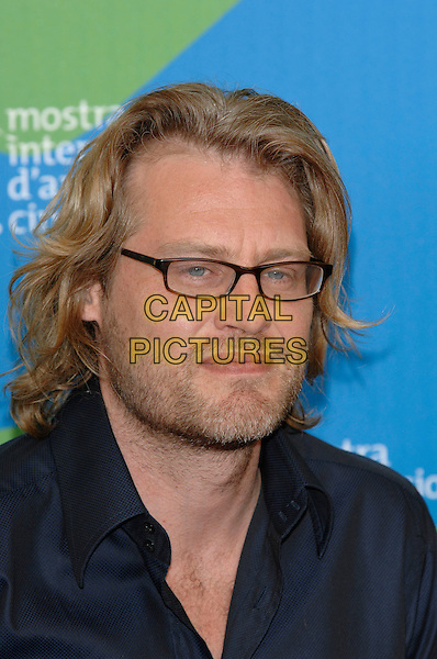 "ANDREW DOMINIK.At the ""The Assasintion of Jesse James by the Coward Robert Ford"" photocall during the 64th Venice International Film Festival, Venice, Italy, .2nd September 2007..La Biennale di Venezia portrait headshot glasses.CAP/PL.©Phil Loftus/Capital Pictures"