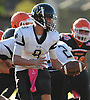West Hempstead quarterback No. 9 Ryan Sandberg prepares to hand off during the fourth quarter of a Nassau County Conference IV varsity football game against host East Rockaway High School on Saturday, October 10, 2015. West Hempstead won by a score of 28-14.<br /> <br /> James Escher