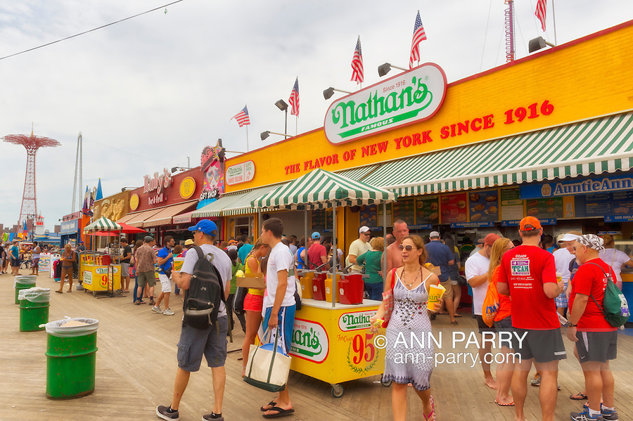Brooklyn, New York, USA. 10th August 2013. The Coney Island Boardwalk is crowded outside Nathan's Famous restaurant, during the 3rd Annual Coney Island History Day celebration. The Parachute Jump ride, no longer in use, is at left in background.