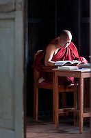 Myanmar, Burma.  Monk Reading Scriptures at Thein Taung Paya monastery, Kalaw, Shan State.