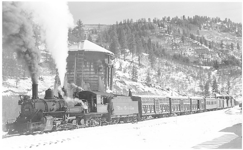 3/4 view of K-27 #452 hauling stock cars at tank at Brown.<br /> D&amp;RGW on RGS  Brown, CO  Taken by Richardson, Robert W. - 11/19/1951
