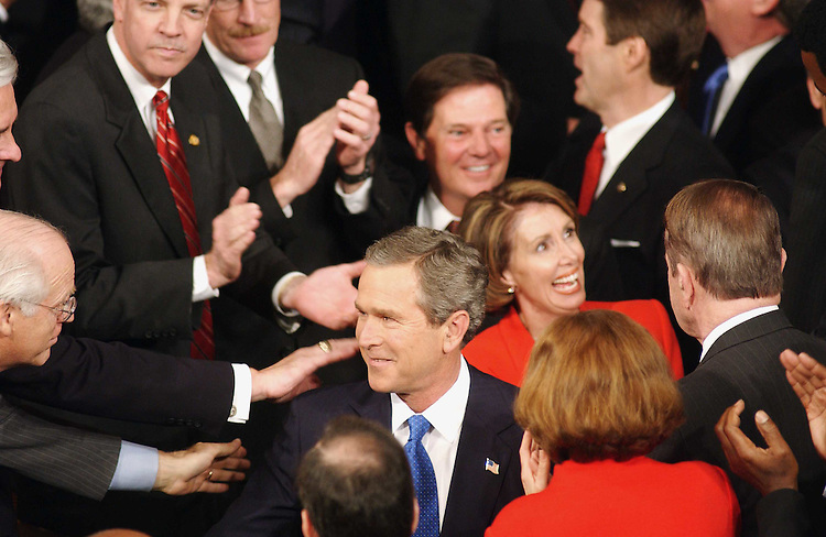 1/28/03.STATE OF THE UNION ADDRESS--President George W. Bush enters the House chamber to deliver the State of the Union address at the U.S. Capitol. With him are House Minority Leader Nancy Pelosi, D-Calif., House Majority Leader Tom DeLay, R-Texas, and Senate Majority Leader Bill Frist, R-Tenn. Rep. Christopher Shays, R-Conn., greets him at left..CONGRESSIONAL QUARTERLY PHOTO BY SCOTT J. FERRELL