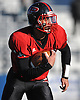 Plainedge quarterback No. 14 Davien Kuinlan rushes for a gain during a Nassau County varsity football Conference III semifinal against Roosevelt at Hofstra University on Saturday, Nov. 14, 2015. He ran for four touchdowns in the first half to lead Plainedge to a 53-13 win.<br /> <br /> James Escher