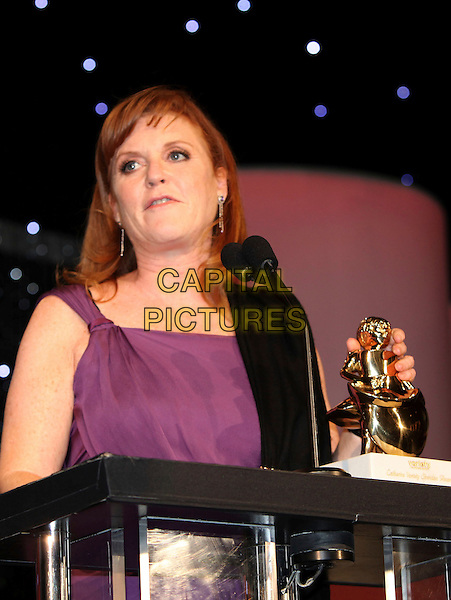 SARAH FERGUSON, DUCHESS OF YORK.The Variety World Conference Awards held At The Renaissance Hotel, Hollywood, California, USA..May 23rd, 2010.half length Fergie purple strapless profile award trophy .CAP/ADM/KB.©Kevan Brooks/AdMedia/Capital Pictures.
