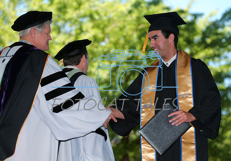 Regent Ron Knecht congratulates graduate Jacob Council at the 2013 Western Nevada College Commencement at the Pony Express Pavilion, in Carson City, Nev., on Monday, May 20, 2013. .Photo by Cathleen Allison