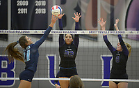 NWA Democrat-Gazette/ANDY SHUPE<br /> Har-Ber's Jayci Carpenter (21) sends the ball over the net as Fayetteville's Haley Warner (32) and Lyndsey Mylius defend Wednesday, Sept. 13, 2017, during play in Bulldog Arena. Visit nwadg.com/photos to see more photographs from the match.