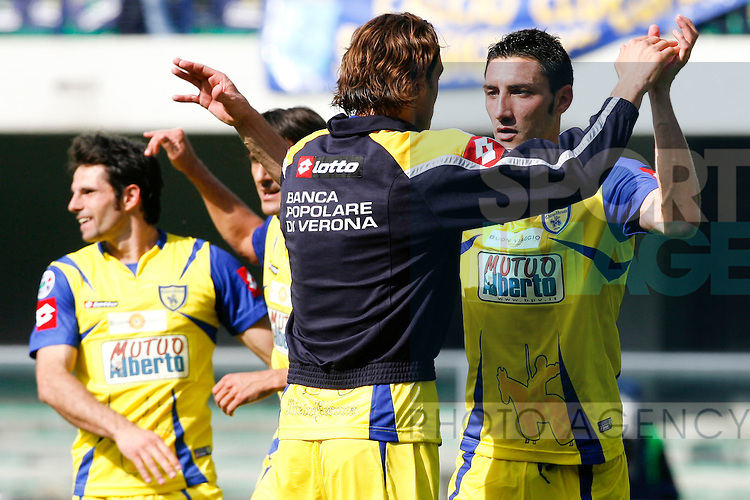 Chievo Verona players celebrate climbing out of the relegation zone after winning 1-0 against Parma