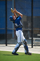 GCL Blue Jays catcher Hagen Danner (33) catches a popup in foul territory during a game against the GCL Pirates on July 20, 2017 at Bobby Mattick Training Center at Englebert Complex in Dunedin, Florida.  GCL Pirates defeated the GCL Blue Jays 11-6 in eleven innings.  (Mike Janes/Four Seam Images)