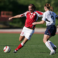 MAR 11, 2006: Quarteira, Portugal:  Denmark forward (17) Marie Herpring punts the ball forward past USWNT defender (3) Christie Rampone at the Algarve Cup in Quarteira, Portugal.