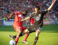 DC United defender Jed Zayner (12) pokes the ball awayl from Chicago Fire forward Patrick Nyarko (14).   The Chicago Fire tied DC United 0-0 at Toyota Park in Bridgeview, IL on Oct. 16, 2010.