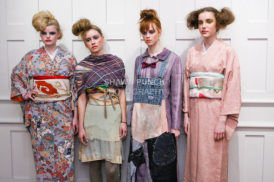 """Models pose in an outfit from the Susan Cianciolo Fall/Winter 2011 """"when buildings meet the sky"""" collection, during New York Fashion Week, February 16, 2011."""
