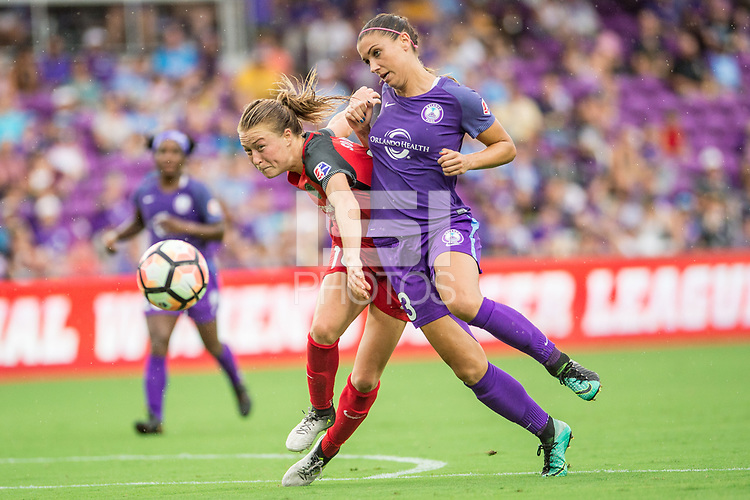 Orlando, FL - Saturday September 23, 2017: Emily Sonnett, Alex Morgan during a regular season National Women's Soccer League (NWSL) match between the Orlando Pride and the Portland Thorns FC at Orlando City Stadium.